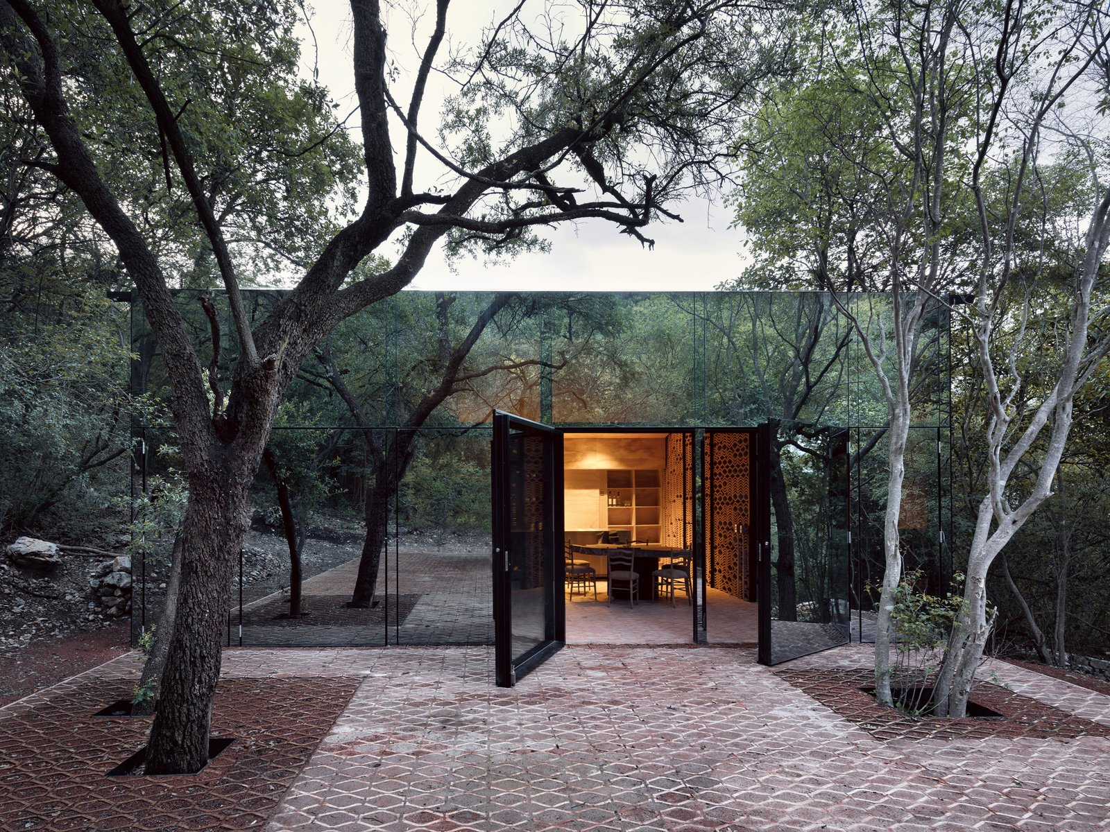 Doors, Swing, and Exterior Mirrored glass allows this holiday home in Mexico to blend in with it's woodland site.  Best Doors Photos from A Mirrored Mexican Home Hides Among a Lush Forest