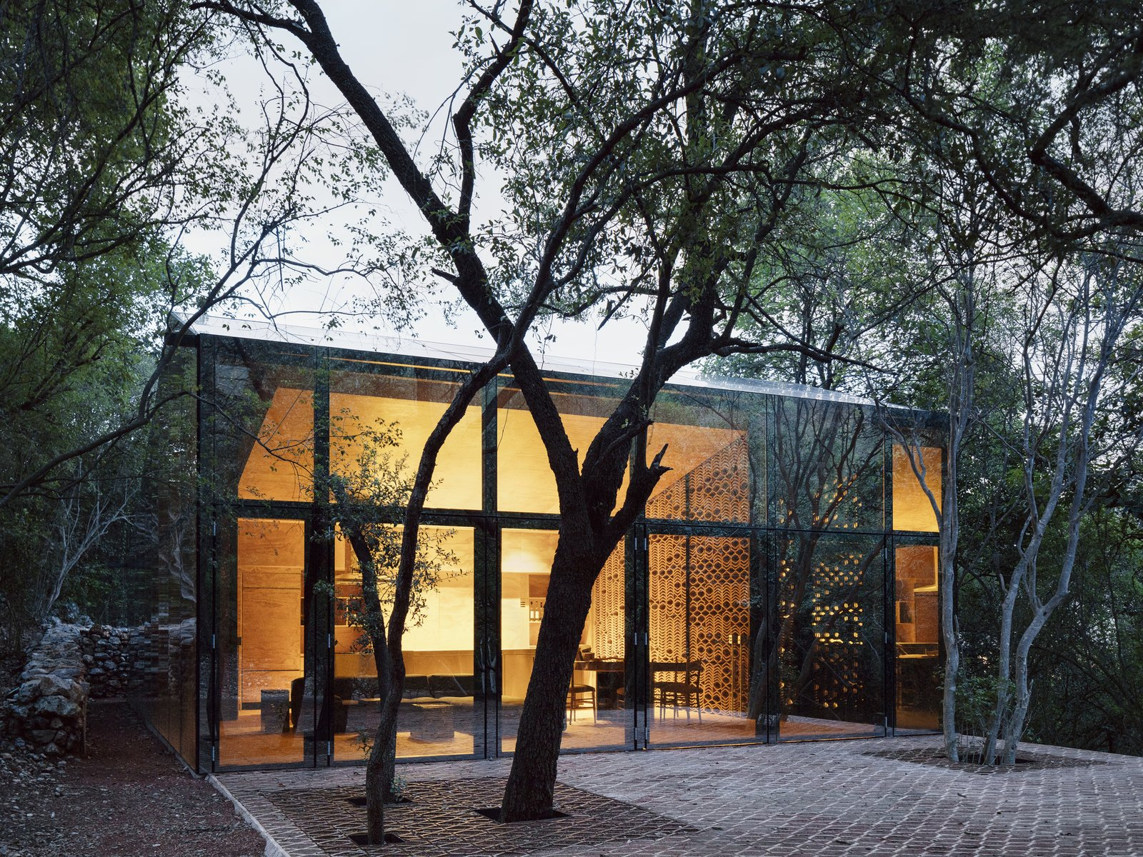 Exterior, House Building Type, and Glass Siding Material The living lounge, dining and kitchen are located within the larger of the two volumes.  Best Photos from A Mirrored Mexican Home Hides Among a Lush Forest