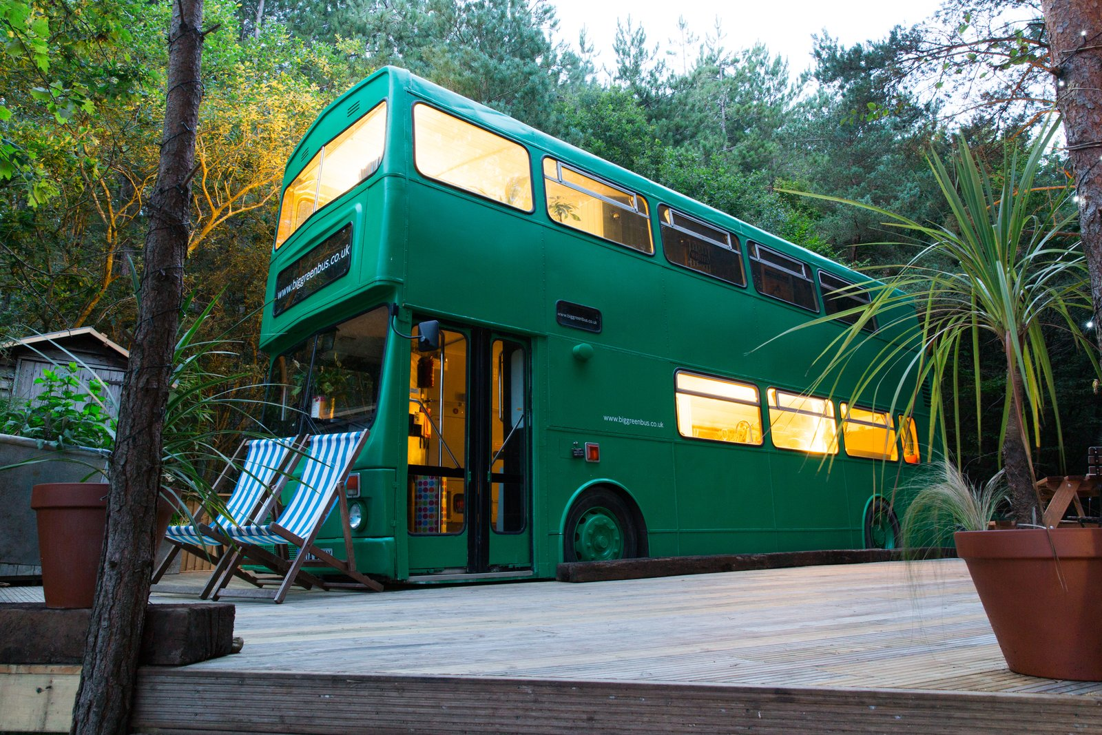 Exterior, Camper Building Type, and Metal Siding Material Guest can also use the picnic table, fire pit and a shower on the site.  Photo 1 of 13 in This Double-Decker Bus Offers an Eclectic Glamping Experience