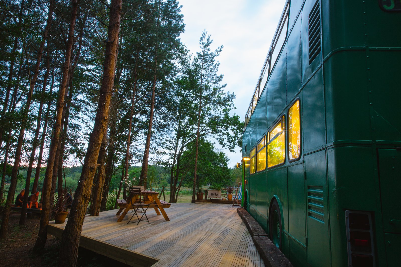 "Exterior, Metal Siding Material, and Camper Building Type The bus is ""parked"" in a peaceful, wooded site in the Surrey countryside.  Photo 12 of 13 in This Double-Decker Bus Offers an Eclectic Glamping Experience"