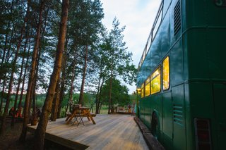 "The bus is ""parked"" in a peaceful, wooded site in the Surrey countryside."