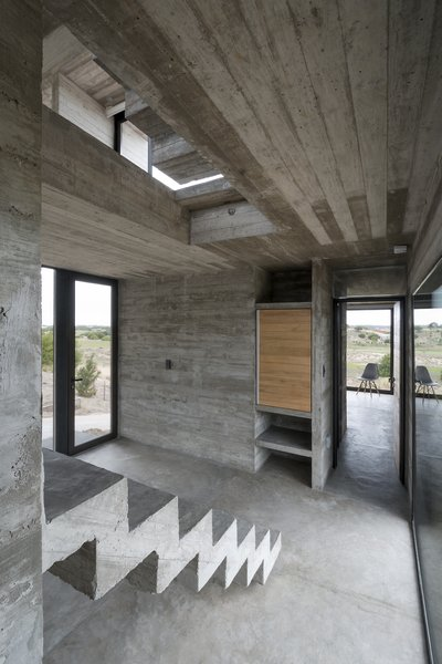 Exposed concrete is used for the rail-less stairs.