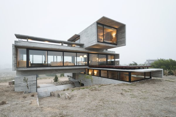 Argentinian architect Luciano Kruk has designed Casa Golf, a striking 2,949-square-foot dwelling that's comprised of three stacked concrete and glass volumes. Soaring high on a 10,764-square-foot plot of land, the contemporary residence is surrounded by breathtaking views and an unparalleled natural environment.