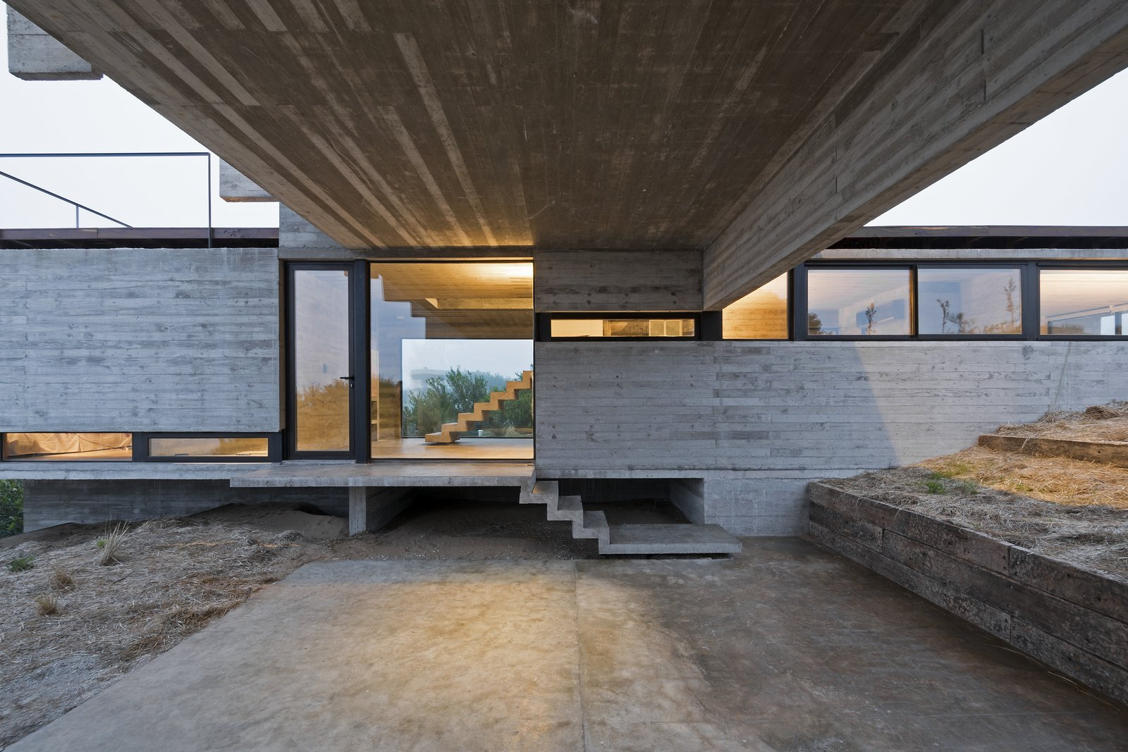 Garage The varied heights of the volumes create interesting interior perspectives.  Best Photos from This Stacked Concrete Home Is Not Your Typical Golf Course Dwelling