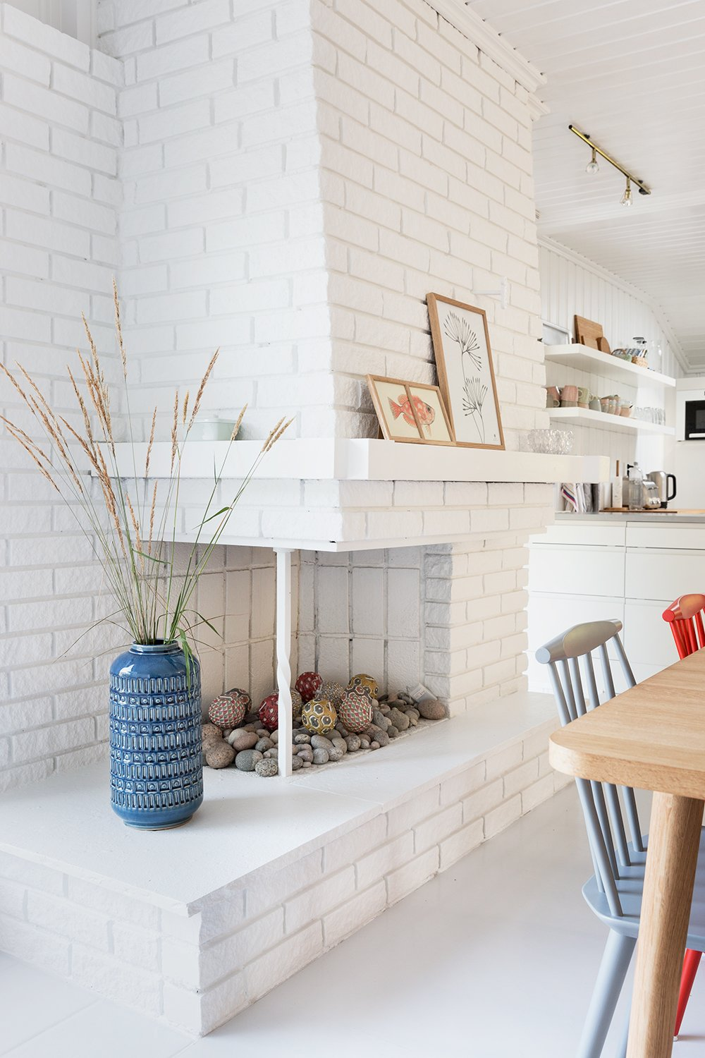 """Dining Room, Table, Chair, and Corner Fireplace An old fireplace was turned into a little rock garden.  Photo 13 of 13 in Relax and Recharge at This Charming Norwegian """"Hytte"""" Rental"""