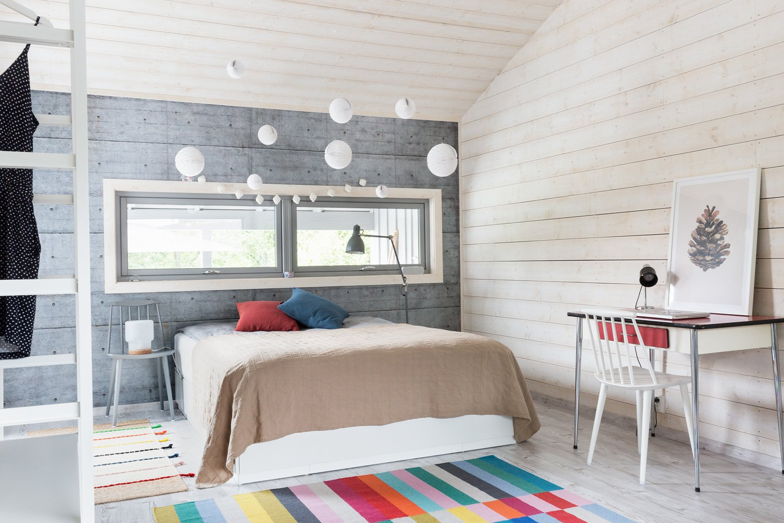 """Bedroom, Chair, Floor Lighting, Light Hardwood Floor, Table Lighting, Bed, and Rug Floor The spacious master bedroom has light wooden floors and walls.  Photo 8 of 13 in Relax and Recharge at This Charming Norwegian """"Hytte"""" Rental"""