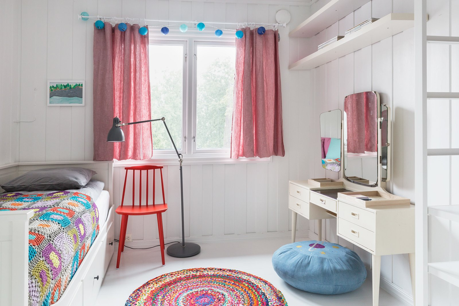 """Kids Room, Bed, Chair, Pre-Teen Age, Dresser, Shelves, Lamps, and Bedroom Room Type Colorful bed spreads and rugs make this a cool bedroom for kids.  Photo 11 of 13 in Relax and Recharge at This Charming Norwegian """"Hytte"""" Rental"""