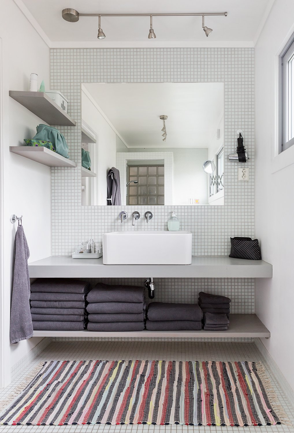 """Bath Room, Vessel Sink, Ceramic Tile Floor, Mosaic Tile Wall, Track Lighting, and Rug Floor Built-in shelves and an unframed mirror give the bathroom vanity a clean and streamlined look.  Photo 12 of 13 in Relax and Recharge at This Charming Norwegian """"Hytte"""" Rental"""