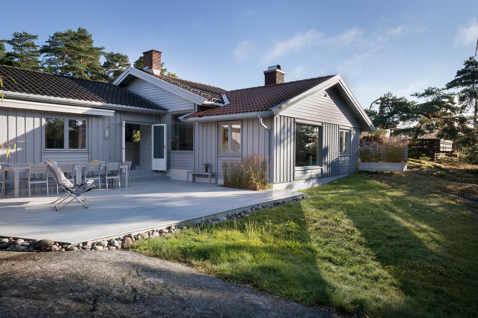 """Exterior, Wood Siding Material, House Building Type, Gable RoofLine, and Tile Roof Material Larvik architect Ulrik Hellum worked with the intention of creating harmony between architecture and natural environment.  Photo 1 of 13 in Relax and Recharge at This Charming Norwegian """"Hytte"""" Rental"""