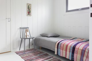 A transit room with a sofa bed.