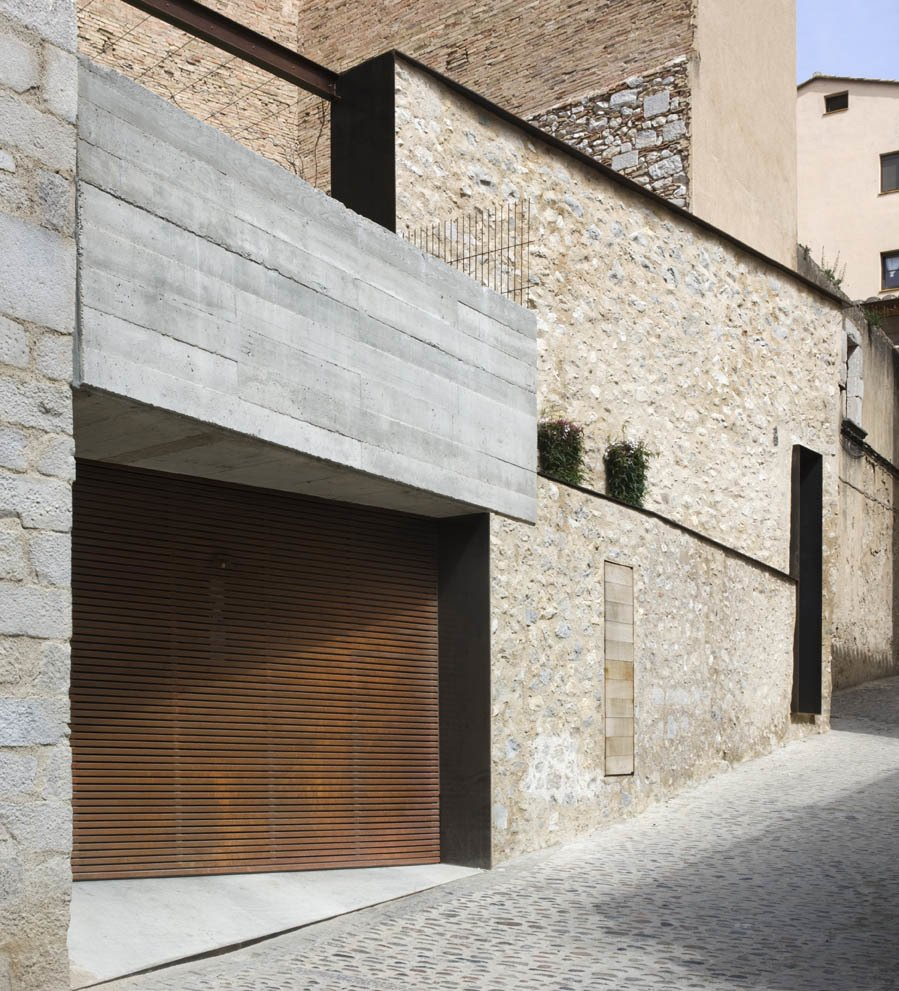 Garage and Garage Conversion The property has a discreet, wooden door garage.  Best Garage Photos from A Spanish Architect Transforms a Medieval Townhouse Into a Stunning Rental