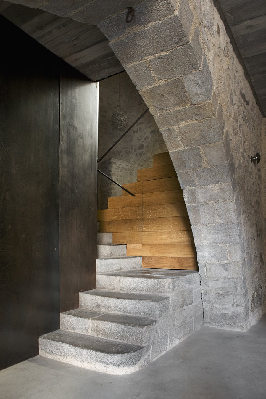 Staircase, Stone Tread, and Wood Tread The entranceway with a stairs that leads to the apartment.  Photo 4 of 15 in A Spanish Architect Transforms a Medieval Townhouse Into a Stunning Rental