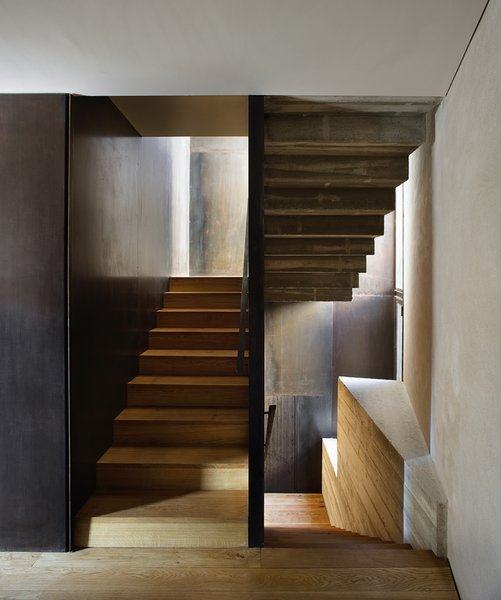 The staircase that leads from the ground-level apartment to the duplex.