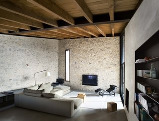 Contemporary materials like concrete and steel are a wonderful contrast to the ancient stone walls.