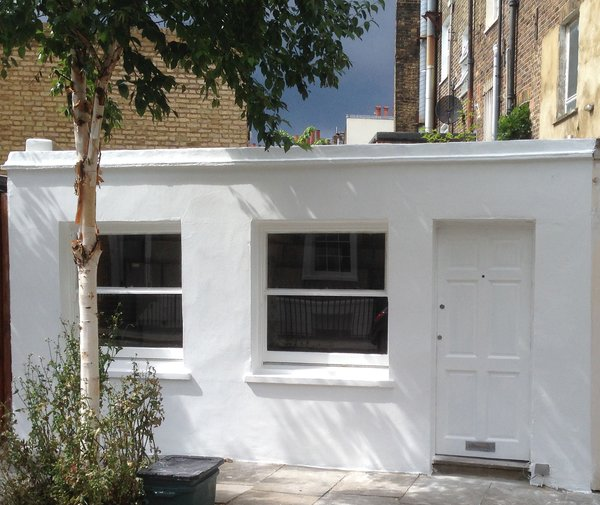 The exterior of a compact 140-square-foot micro-apartment in north London.
