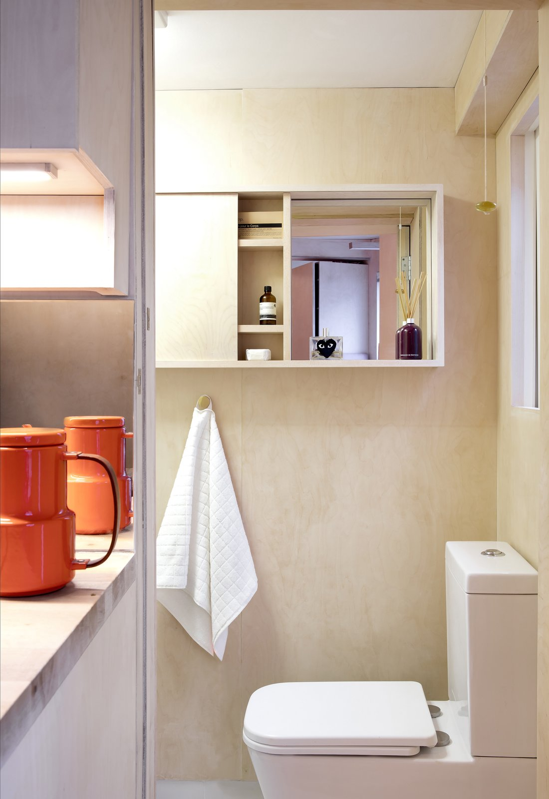 Bath Room, Wood Counter, and One Piece Toilet The bathroom is the only space that's separated by a wall.  Photos from This Tiny 140-Square-Foot Apartment Boasts Comfort and Function