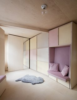 """""""We have created small spaces before, but this was a great challenge as it was impossible to get a small space like this to work using off-the-shelf furniture,"""" says Studiomama cofounder Nina Tolstrup, who hired East London carpentry firm Commission by you to build the bespoke furniture units. A fully concealed workstation and storage reside next to a cozy bench seat."""