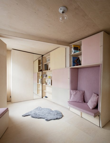 The cabinet doors slide to reveal book shelves.