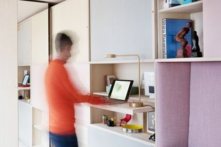 A standing work station with a pullout desk.