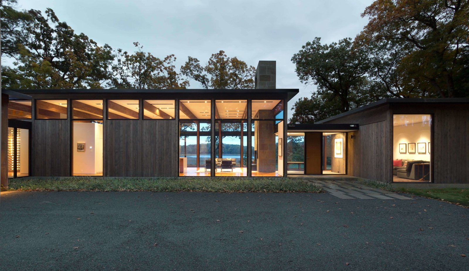 """Exterior, Wood Siding Material, Metal Siding Material, Glass Siding Material, Metal Roof Material, House Building Type, and Flat RoofLine Californian modernism informs the shape of this Minnesota residence.  Best Photos from This Glass House and """"Shiny Shed"""" Merge With Nature in Minnesota"""