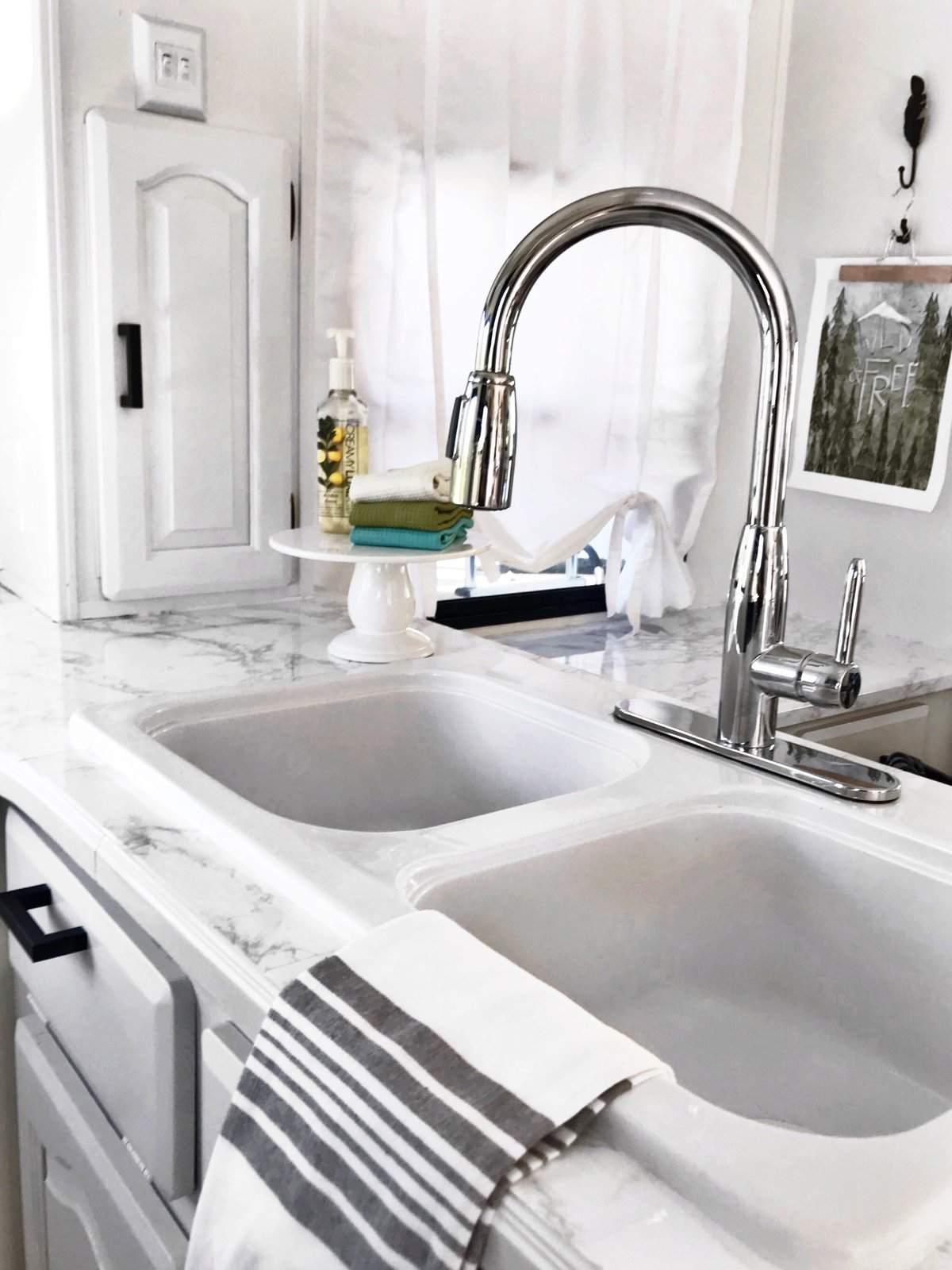 Kitchen, Drop In Sink, and Marble Counter A gray, Hemnes/Rattviken sink cabinet from Ikea with two drawers.  Photo 12 of 16 in Hit the Road With This Chic Camper on Sale For $28K