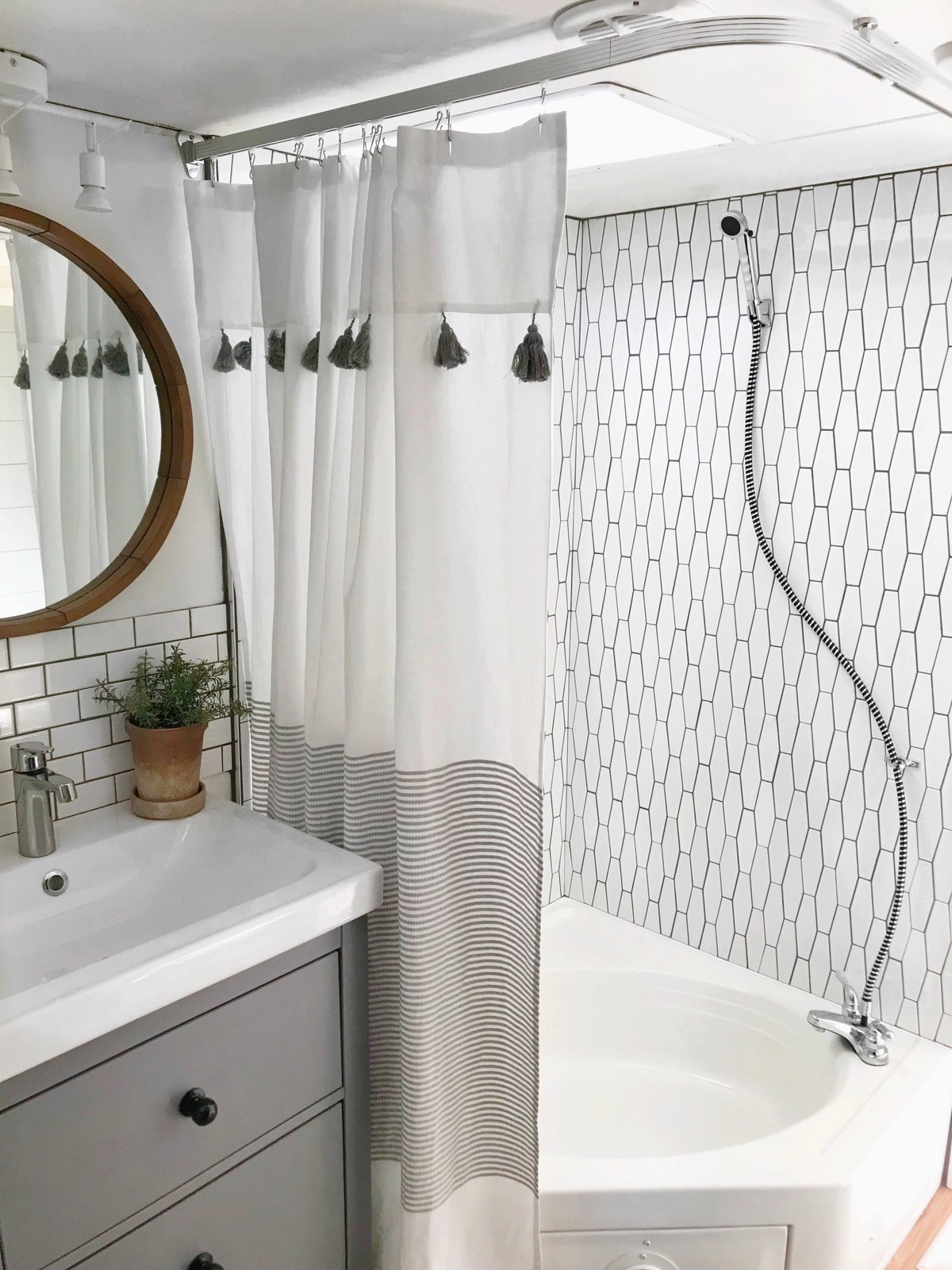Bath Room, Track Lighting, Subway Tile Wall, Corner Shower, and Drop In Sink A renovated bathroom with a new showerstall and tiled wall.  Photo 9 of 16 in Hit the Road With This Chic Camper on Sale For $28K