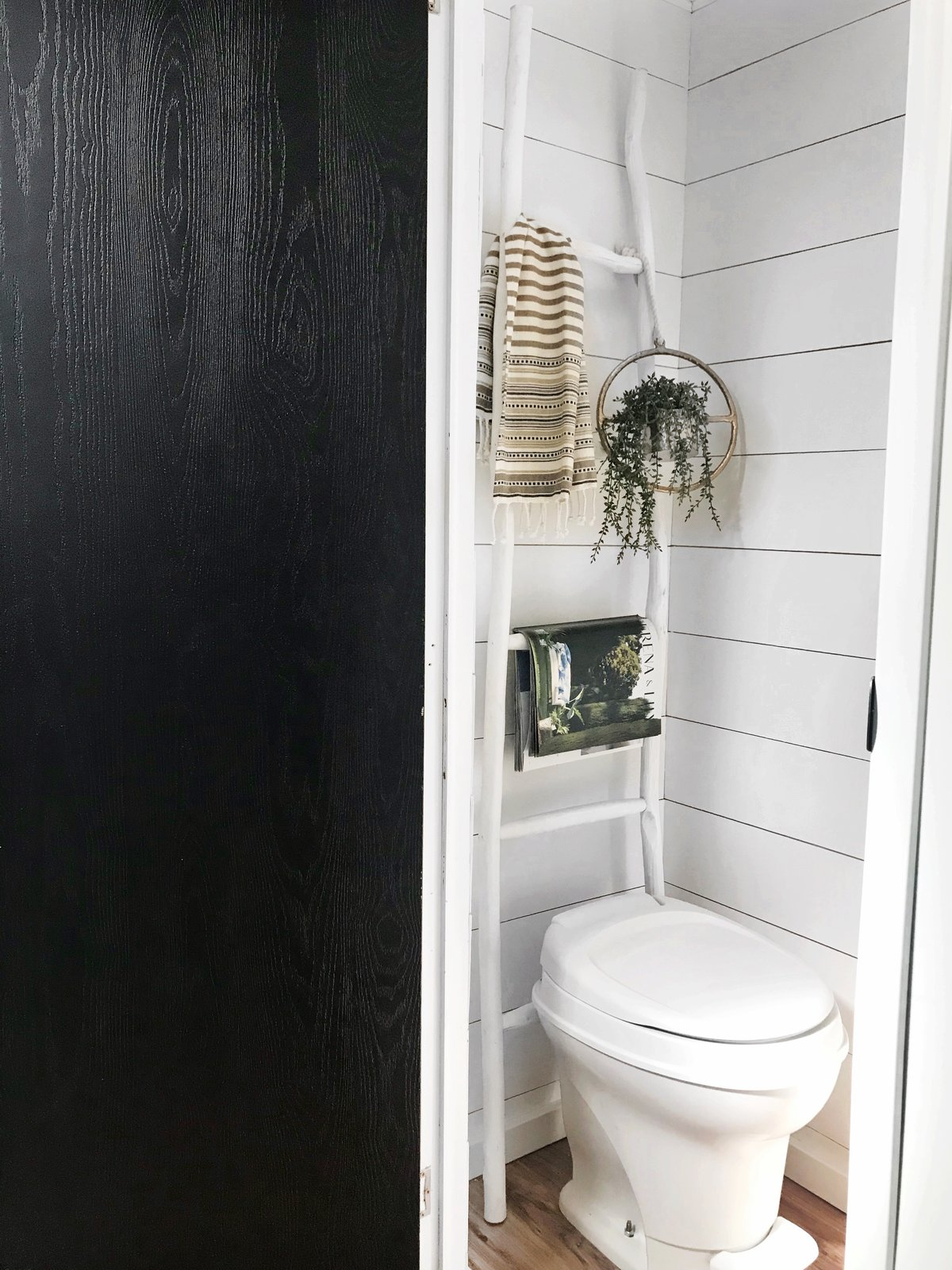 Bath Room and One Piece Toilet The walls of the bathroom were painted white.  Photo 14 of 16 in Hit the Road With This Chic Camper on Sale For $28K