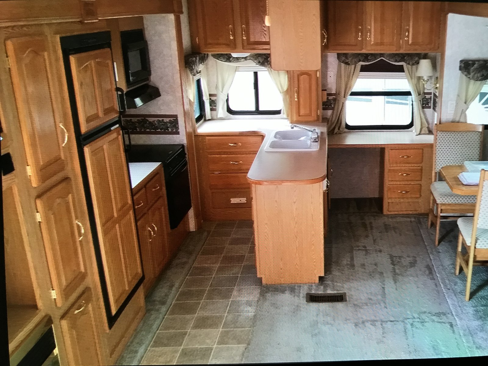 Kitchen The kitchen before the renovation.  Photo 3 of 16 in Hit the Road With This Chic Camper on Sale For $28K