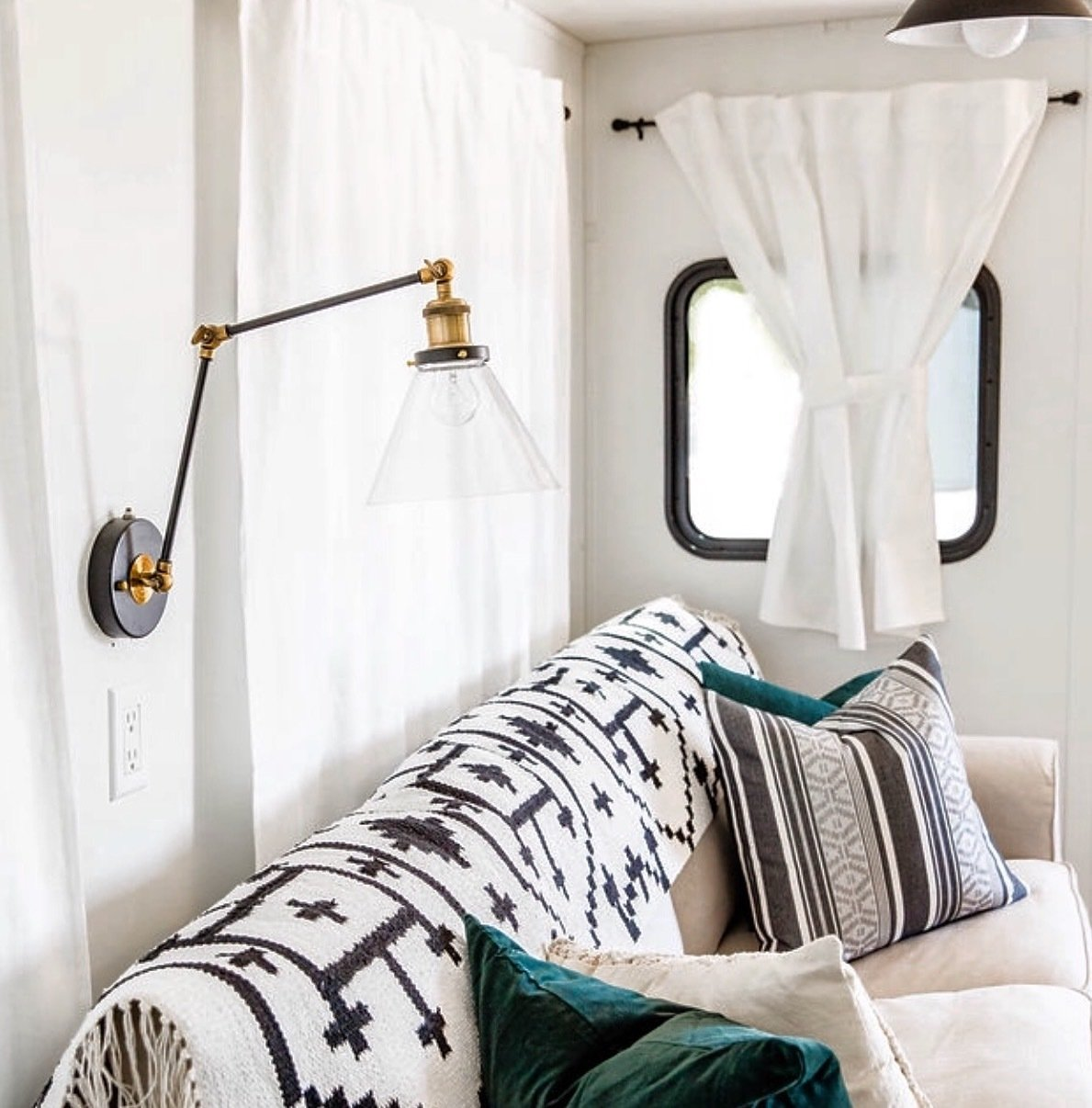 Living Room, Sofa, and Wall Lighting LNC Plug-in Wall Lamp with swing arm from World Market.  Photo 8 of 16 in Hit the Road With This Chic Camper on Sale For $28K