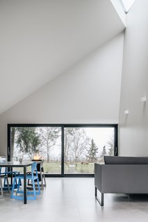 The sloping ceiling creates a varied sense of space within each cabin.