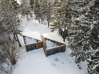 The pyramidal roofs of the cabins allow snow to slide down to the ground.