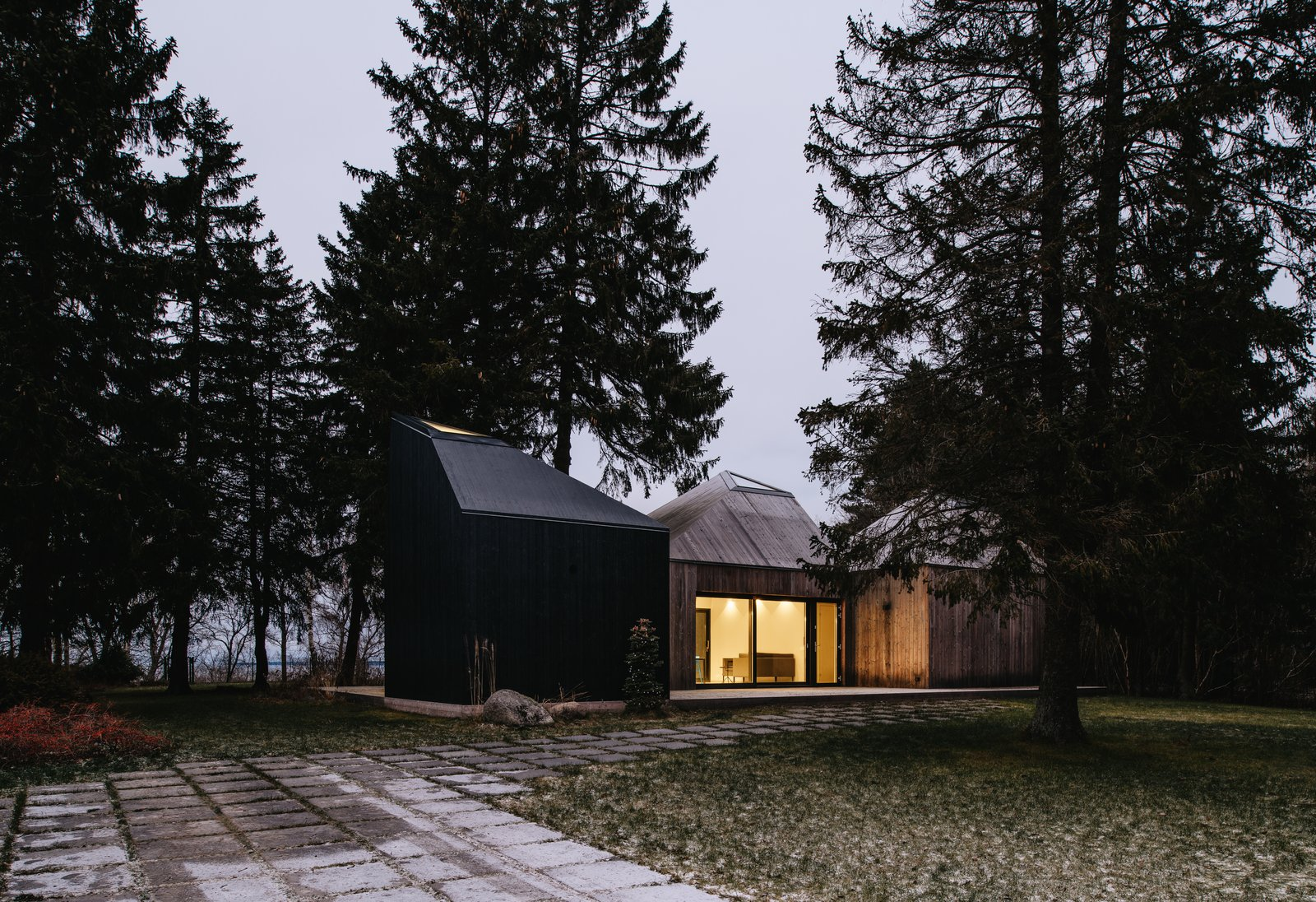 Exterior, Wood Siding Material, Cabin Building Type, and House Building Type The three cabins have north-facing windows that frame views of the Baltic Sea.  Photo 3 of 13 in This Forest Retreat Is a Modern Take on the Traditional Estonian Hut