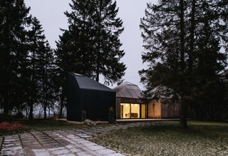 The three cabins have north-facing windows that frame views of the Baltic Sea.