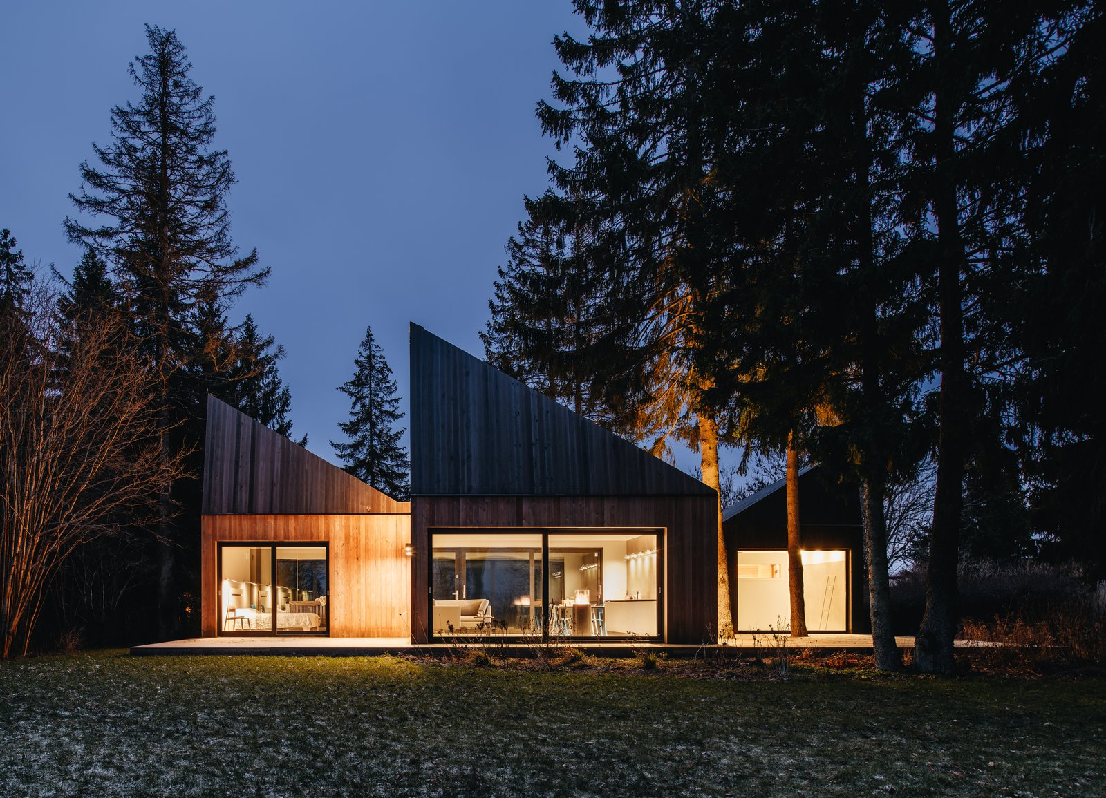 "Exterior, House Building Type, Cabin Building Type, and Wood Siding Material KUU arhitektid who designed this retreat says they were inspired by traditional Estonian ""koda"" huts.  Photo 4 of 13 in This Forest Retreat Is a Modern Take on the Traditional Estonian Hut"