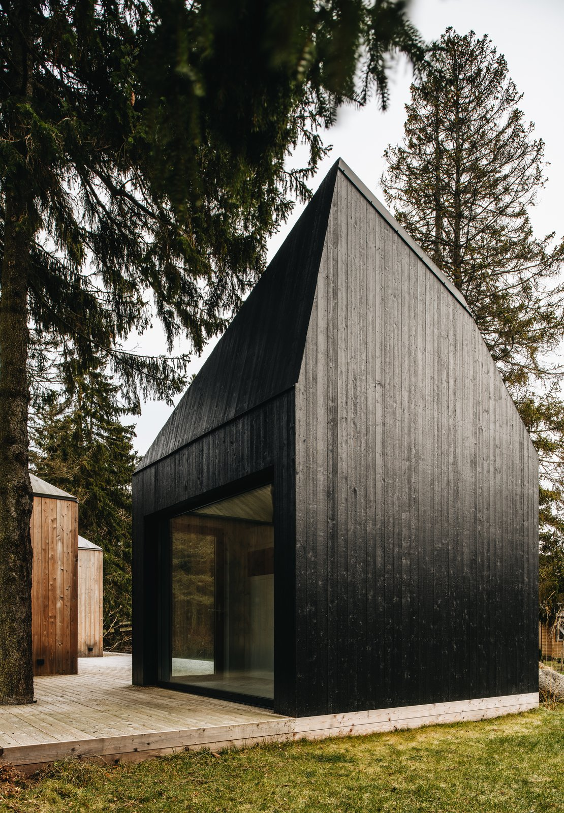 Exterior, Cabin Building Type, and Wood Siding Material The cabin where the sauna is located was painted in black tar.  Photos from This Forest Retreat Is a Modern Take on the Traditional Estonian Hut