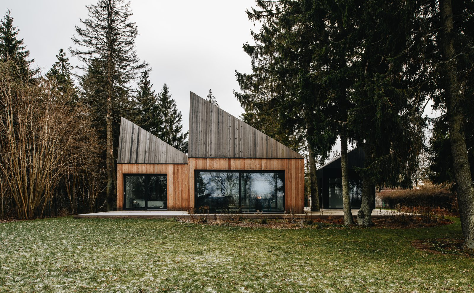 Exterior, Wood Siding Material, Cabin Building Type, and House Building Type The larch wood cladding helps the cabins blend in with their forest site.  Photo 1 of 13 in This Forest Retreat Is a Modern Take on the Traditional Estonian Hut