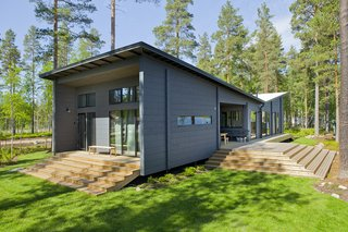 Winner of the 2011 Log House of the Year Award, the 1,206-square-meter Lokki, which was designed by as architect Kari Lappalainen, and furnished by interior designer Hanni Koroma, has an inverted pitch roof that's inspired by seagull wings.