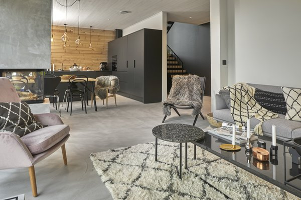Furnished by interior designer Jonna Kivilahti, this compact, two-story detached Honka Fusion home near lake Saimma in Mikkeli, Finland was inspired by the traditional steeped roof cottages of Denmark.