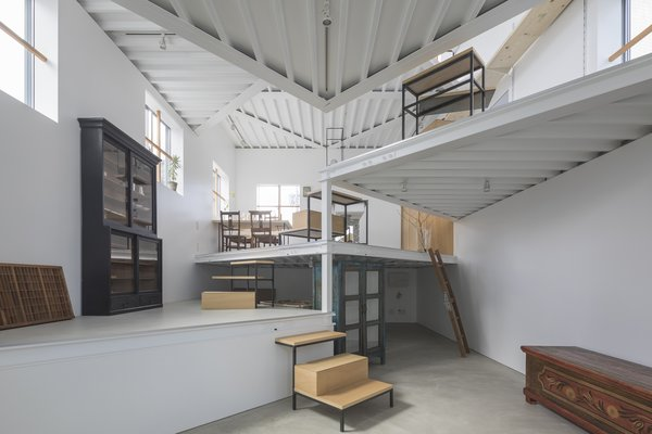 Angular, flag-shaped platforms increases floor space vertically.