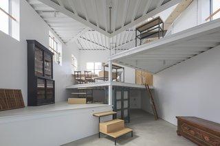 Angular, flag-shaped platforms increase floor space vertically.
