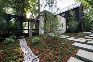 The home features a beautiful garden, designed and landscaped by Marpa.