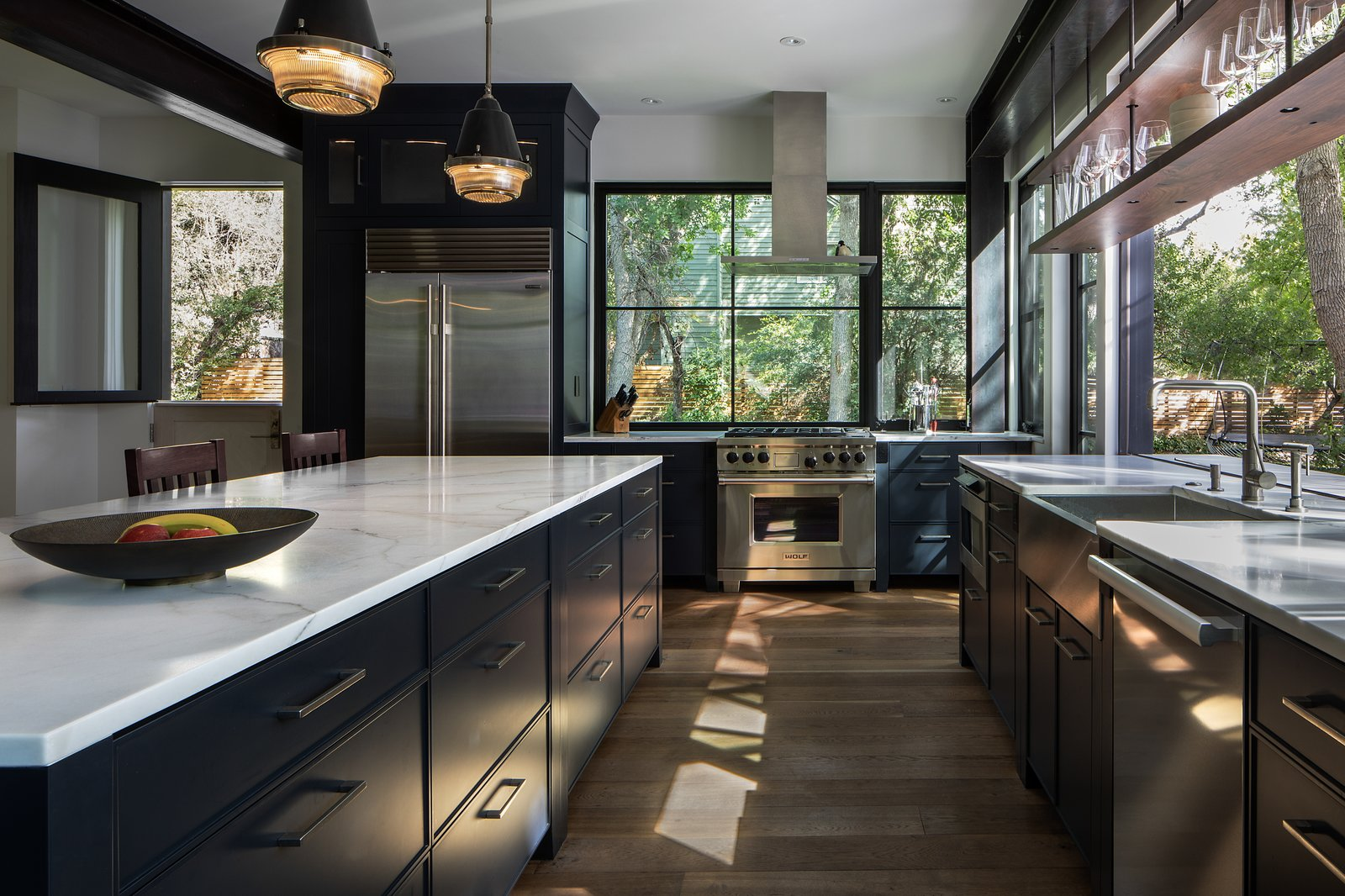 Modern farmhouse interior kitchen with range and range hood.