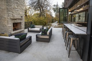 The kitchen bar counter extends out to the patio, creating a great space for entertaining.