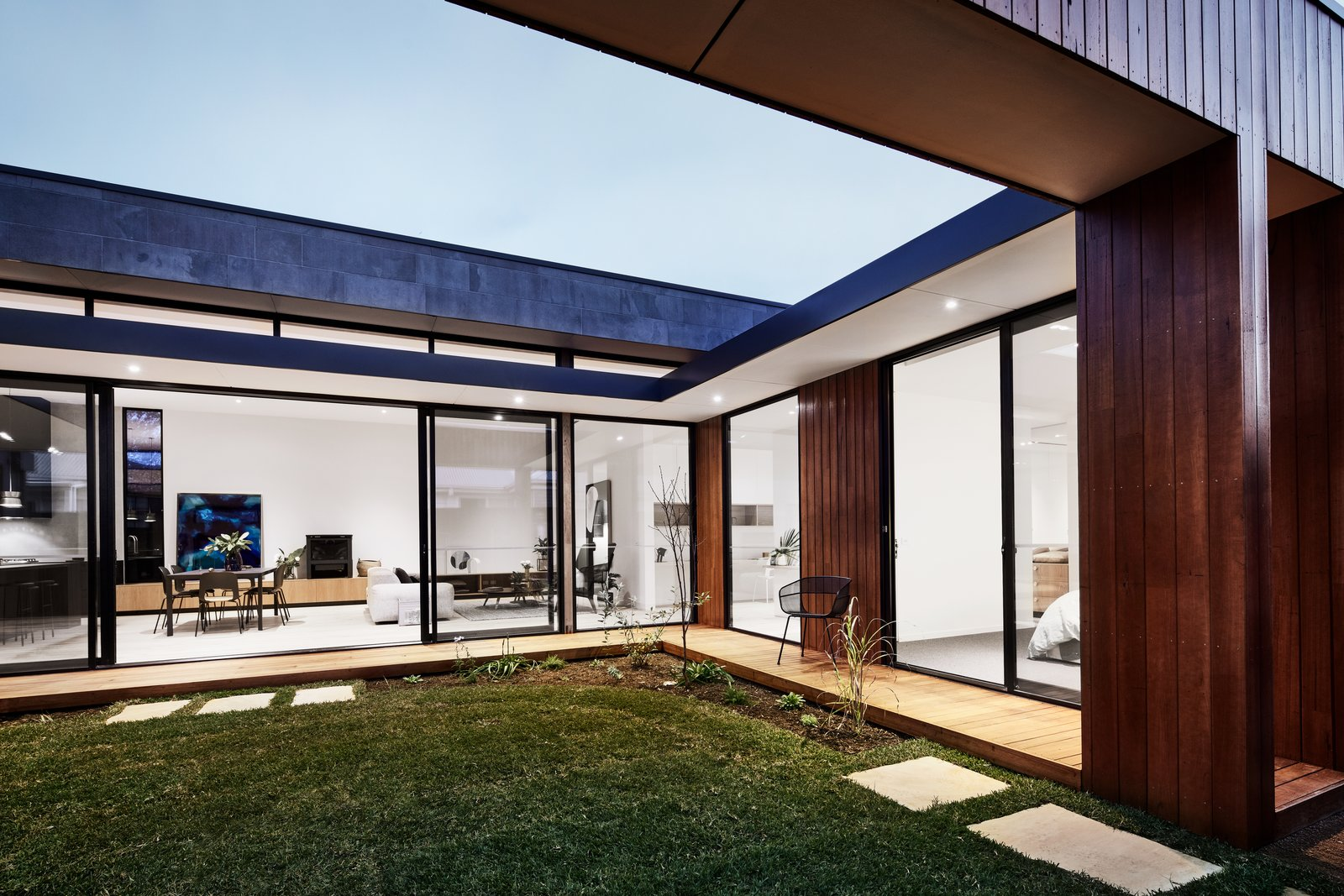 All the spaces in the house enjoy courtyard access.