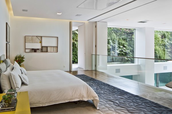 The fitness room and the master bedroom lead out to a veranda, which the owners can use to access the pool.