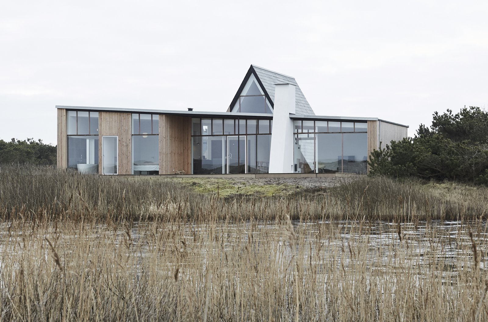 Exterior, A-Frame, Wood, House, and Glass A lakeside vacation home near the village of Agger in Denmark.  Exterior House Glass A-Frame Photos from Landscape