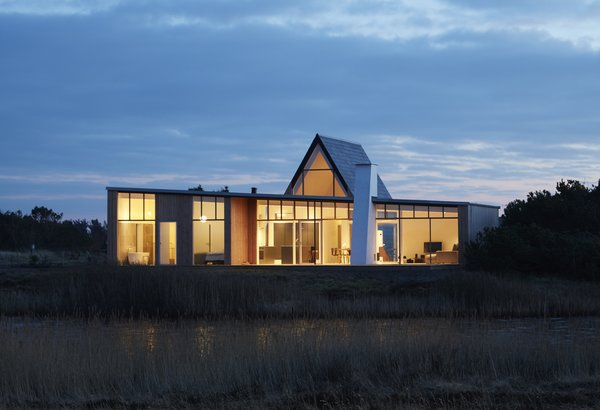 The Light House is a vacation home in Denmark designed by Søren Sarup of Danish firm Puras Architecture. It consists of a low-lying Douglas fir–clad volume topped with a slate-covered A-frame.