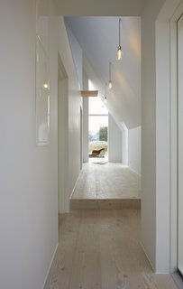 Pale wooden floors and white walls brighten the interiors.