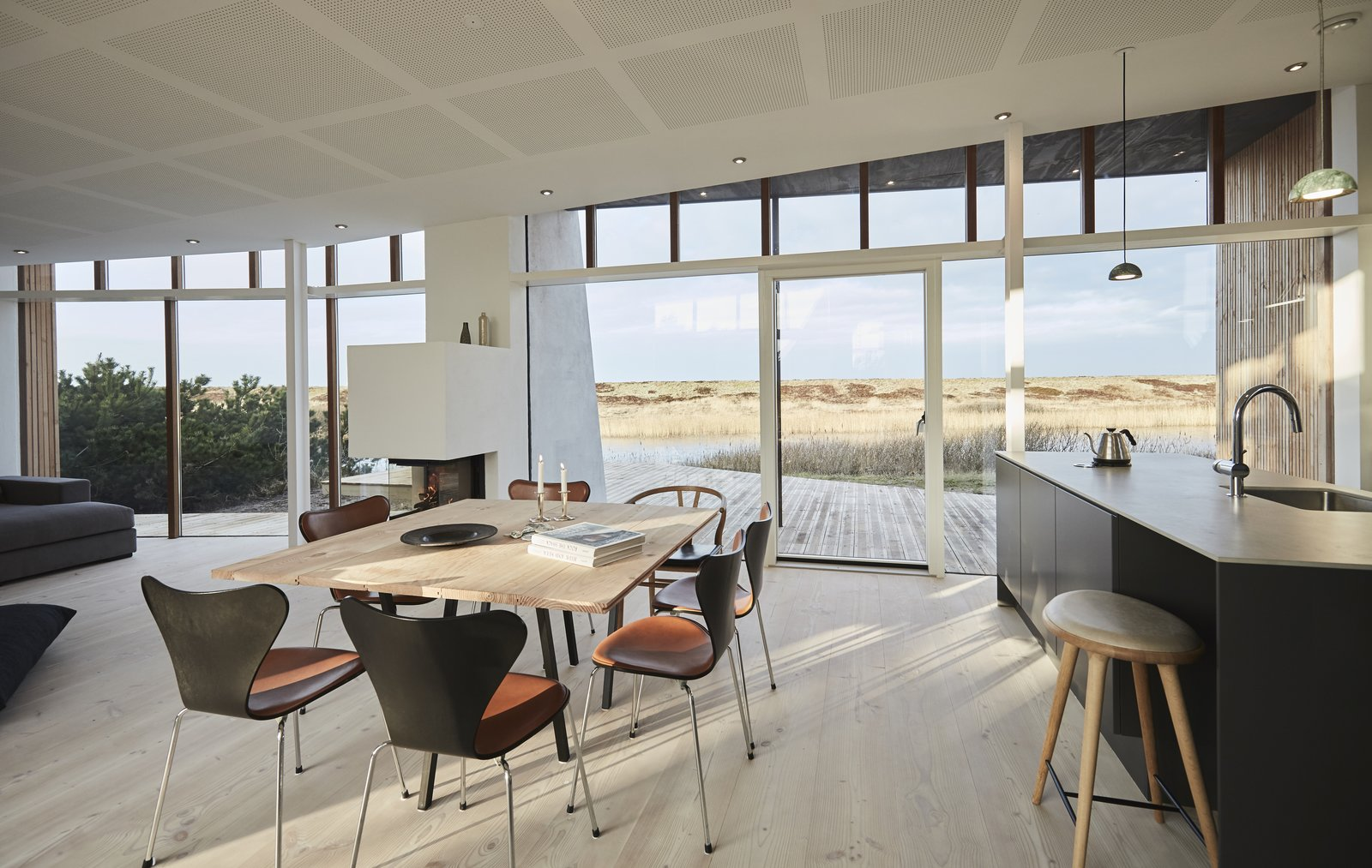 Dining, Pendant, Table, Chair, Light Hardwood, Recessed, and Wood Burning Typical of modern Scandinavian homes, the interiors are bright and airy.  Best Dining Wood Burning Light Hardwood Photos from Rent This Danish A-Frame For Your Next Nordic Escape