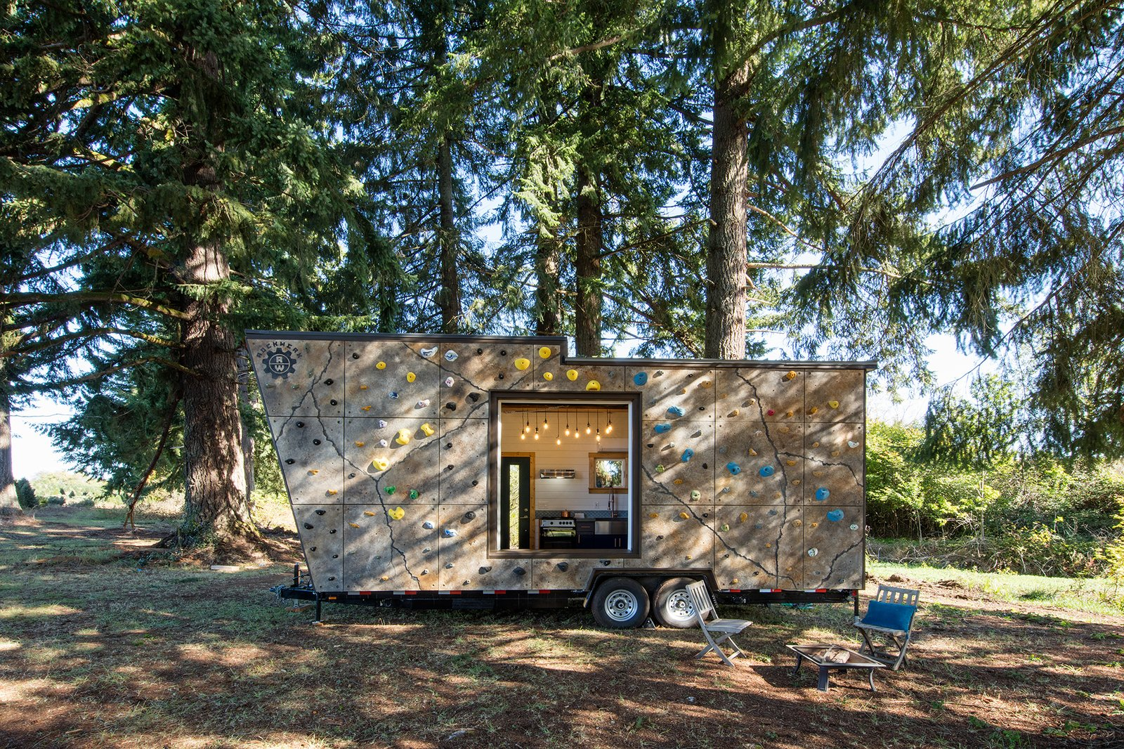 Exterior, Tiny Home, Camper, Wood, and Flat A custom rock wall system that takes care of the couple's shared passion for bouldering.  Best Exterior Wood Camper Photos from Off The Grid